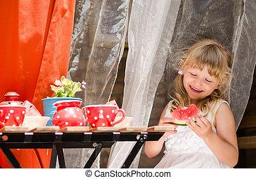 smiling girl drinking tea