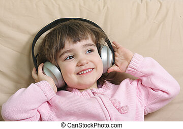 Smiling girl enjoying music