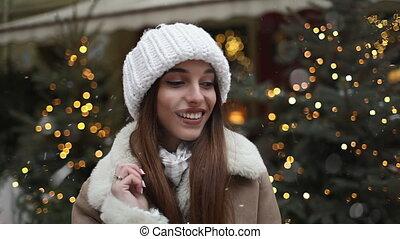Smiling Girl Enjoying snowfall - Happy girl enjoying...