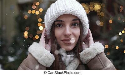 Smiling Girl Enjoying Snowfall on the Street