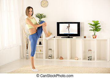Smiling Girl Exercise In Front Of TV