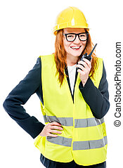 smiling girl foreman with radio in hand on white background