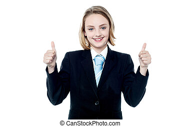 Smiling girl gesturing double thumbs up