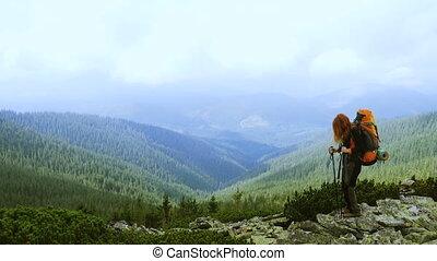 smiling girl hiker on mountain summit - smiling girl...