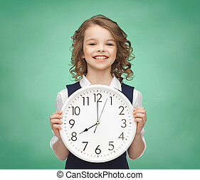 smiling girl holding big clock - people, time management and...