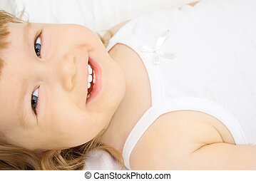 Smiling girl in a bed