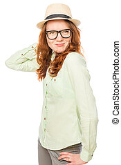 smiling girl in a green shirt and hat posing
