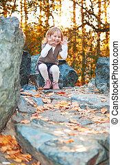 Smiling girl in autumn park