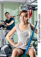 Smiling girl in fitness center