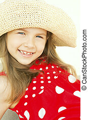 smiling girl in hat on beach