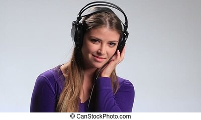 Smiling girl in headphones listening mp3 player - Seductive...