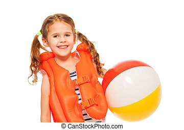 Smiling girl in lifejacket with colored wind-ball