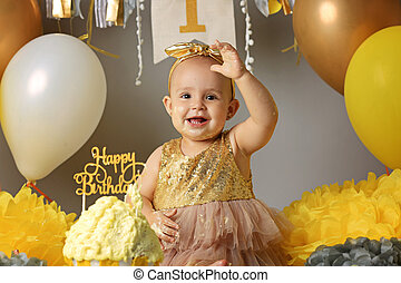 Smiling girl in party hat with birthday cake