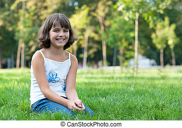 Smiling girl in the autumn park