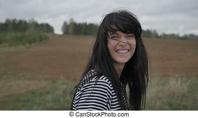 Smiling girl in the field