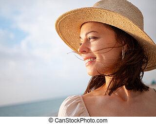 Smiling girl in the sun