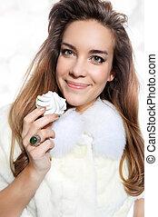 Smiling girl in white fur with meri