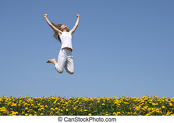Smiling girl jumping - Smiling young woman in a happy jump ...