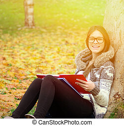 Smiling girl learning in nature