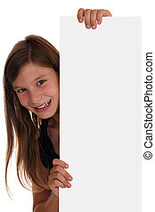 Smiling girl looking behind an empty banner with copyspace