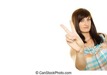Smiling girl making victory gesture