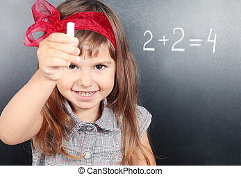 Girl Near Blackboard Showing Chalk