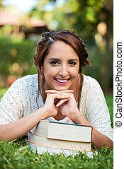 smiling girl on books
