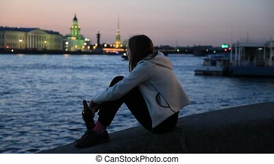 Smiling girl on embankment at night