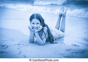 Smiling girl on the beach