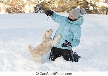 Smiling girl playing with dog