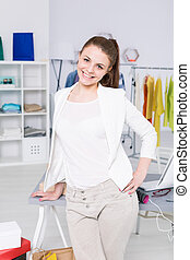 Smiling girl posing for a photo in an office