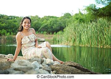 smiling girl relax on lake