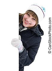 Smiling girl round the corner isolated on white background