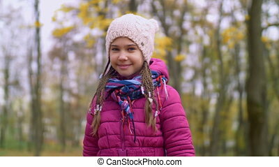Smiling girl showing bouguet of autumn leaves - Positive...