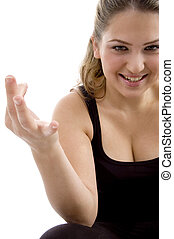 smiling girl showing hand gesture on an isolated background