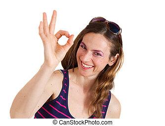 smiling girl showing OK sign
