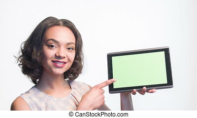 Smiling girl showing on her tablet