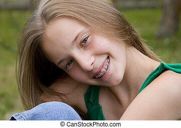 Smiling girl siting on grass