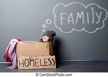 Smiling girl sitting in a paper box, sign Homeless