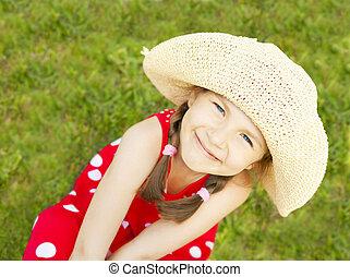 smiling girl sitting in garden