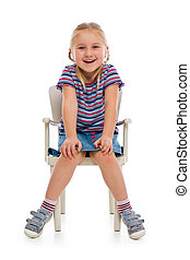 smiling girl sitting on a chair