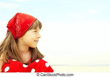 smiling girl sitting on beach