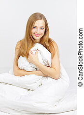 Smiling girl sitting on the bed
