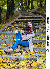 smiling girl sitting on the stairs