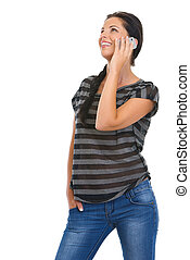 Smiling girl speaking mobile phone and looking on copy space