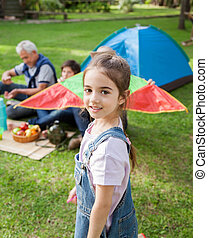 Smiling Girl Standing At Campsite