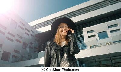 Smiling Girl Talks on Phone