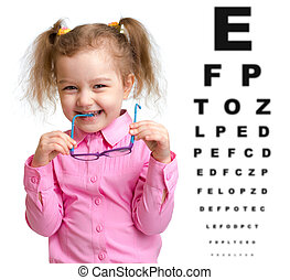 Smiling girl took off glasses with blurry eye chart behind ...