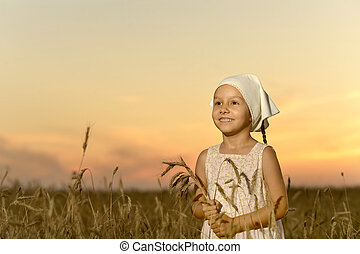 Smiling girl vilager in field