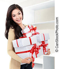 smiling girl with a gift boxes